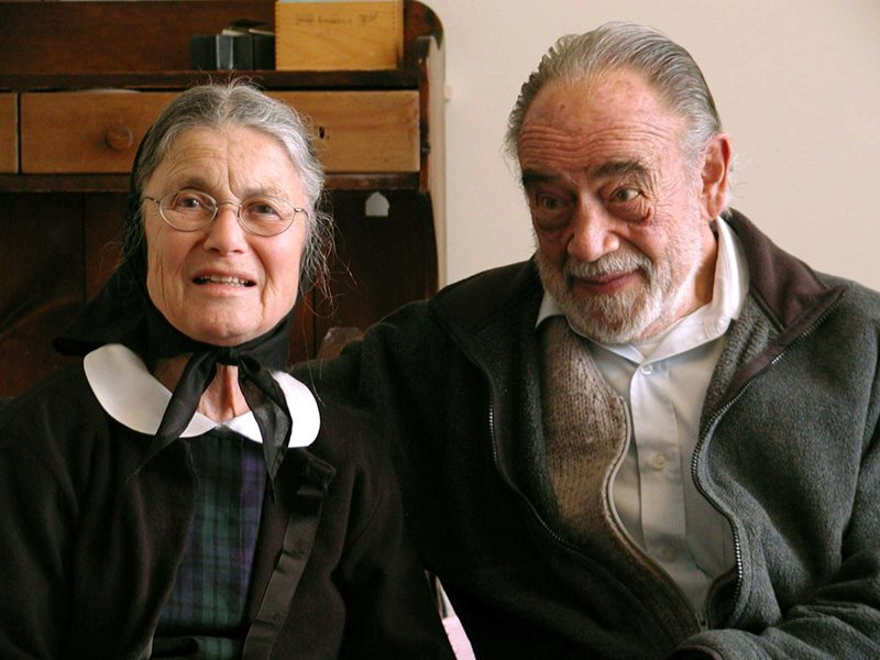 An image of an elderly Bruderhof couple