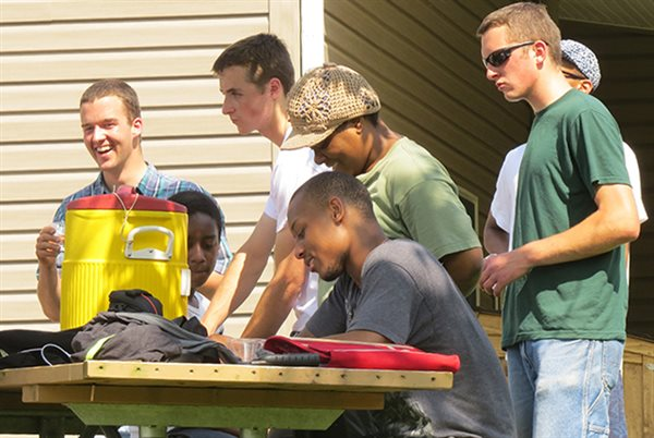 young people fellowshipping outdoors together