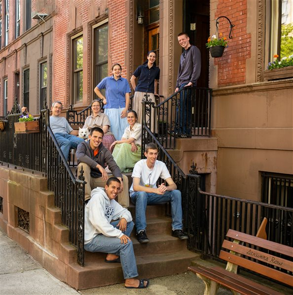 Community members on the front steps of the Harlem Bruderhof House