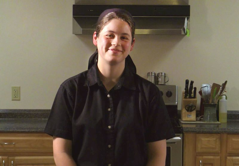 An image of a Bruderhof house wife in the kitchen