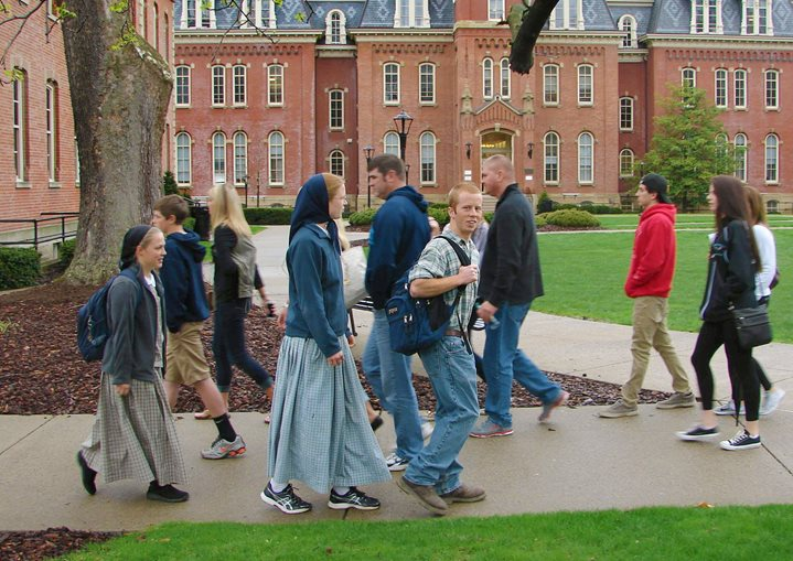 An image of Bruderhof students walking through the college campus they attend