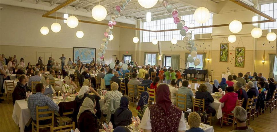 An image of a wedding anniversary celebration in the dining hall of the Bellvale Bruderhof community