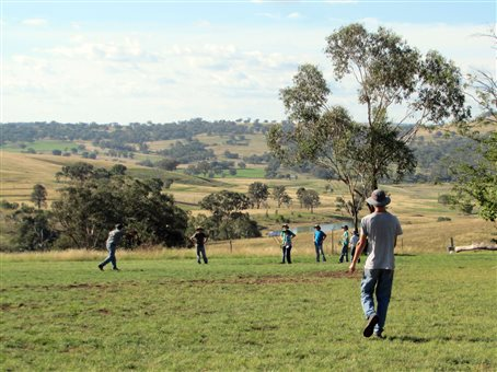 An image of some school boys playing a ball game in a field at the Danthonia Bruderhof community