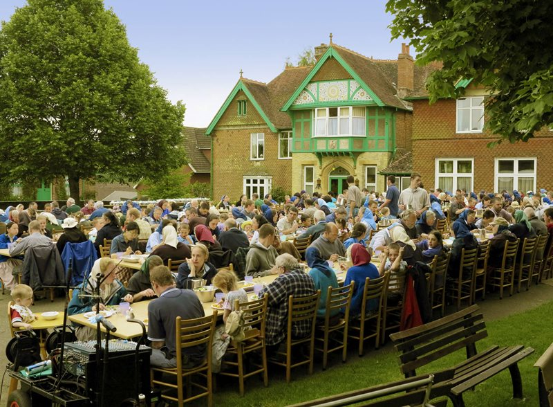 A photo of an outdoor meal at the Darvell Bruderhof community