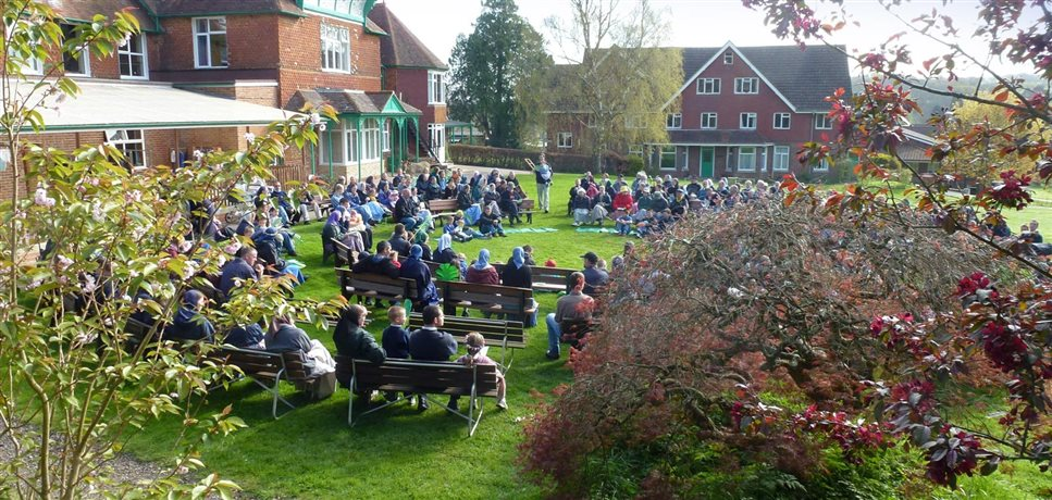 An outdoor gathering of the Darvell Bruderhof community