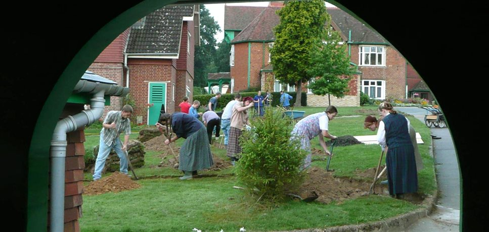 An image of the Darvell youth group doing a landscaping project