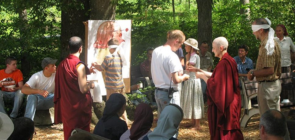 A group of children and adults from the Bruderhof enjoying a game with some visitors from a Buddist Temple.
