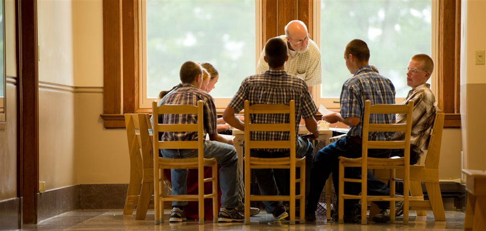 An image of a teacher at the Mount Academy giving a lesson to a small class