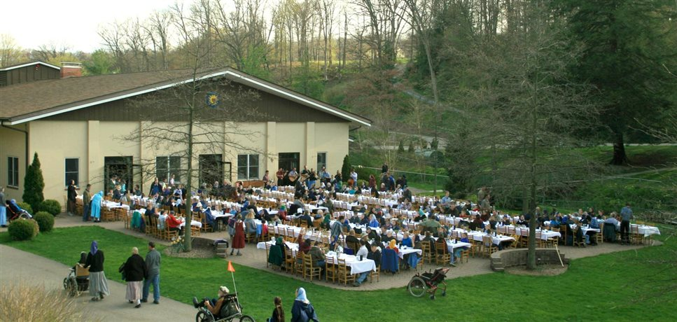 A photo of an outdoor mealtime on the patio at New Meadow Run Bruderhof