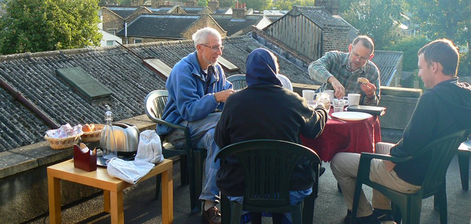 four community members gathered for a rooftop breakfast