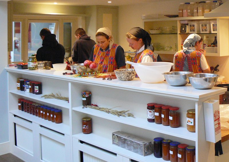 several young women working together in the kitchen of the Peckham community house