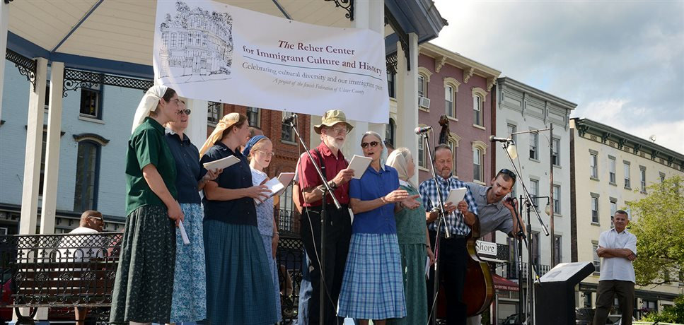 An image of some of the Rondout Bruderhof members singing at a local event