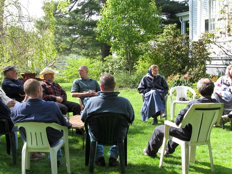 An image of members of the Rondout community sitting in lawnchairs outdoors