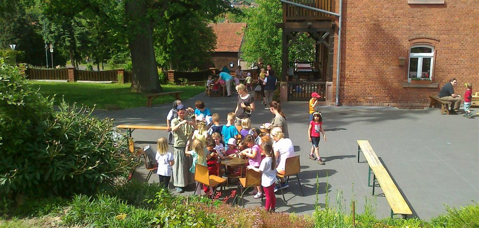 An image of a children's festival at the Sannerz Bruderhof community with outdoor activities