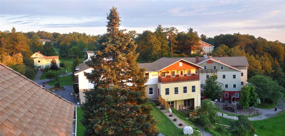 An image of some of the buildings at the Woodcrest Bruderhof at sunset
