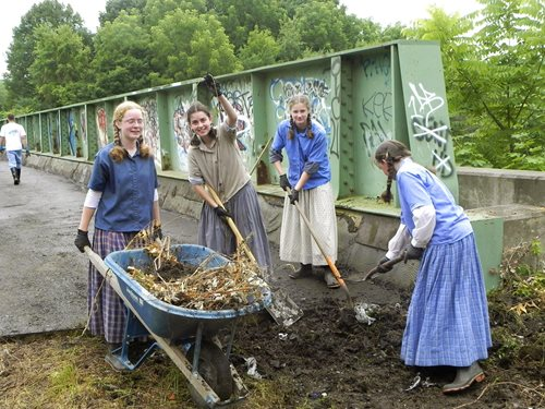 Bruderhof young people help with trail maintenance at a local rail trail