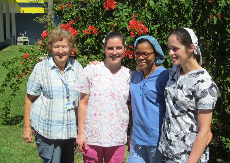 two young women from the Bruderhof with other women from a medical missions team they were a part of
