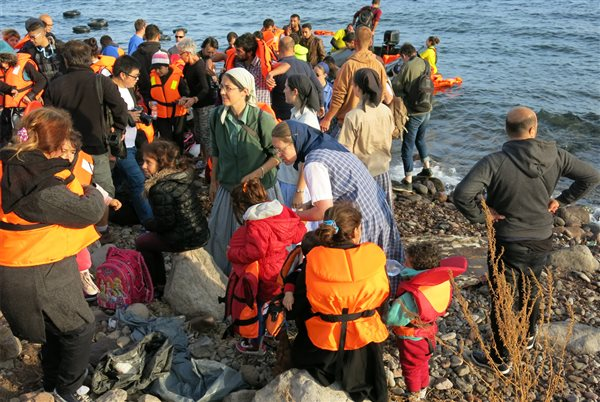 Young men and women frwelcoming refugees ashore on the Greek island of Lesboom the Bruderhof s