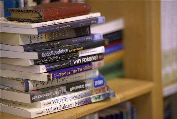 An image of a stack of books published by the Plough Publishing House