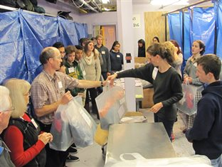 Members of the Bruderhof helping with a clothing distribution at the Bowery Mission