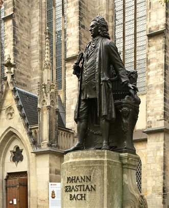 a statue of Bach outside the Thomaskirche in Leipzig