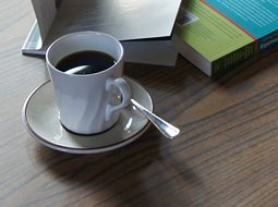 coffee cup and books on a table