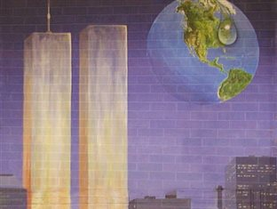 a mural painted on a brick wall in memory of September 11: the illuminated towers with lilies at the base