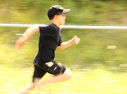 a young boy running in a race