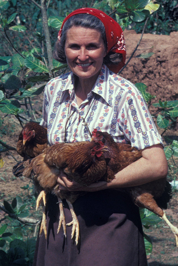 Sarah Corson holding several chickens