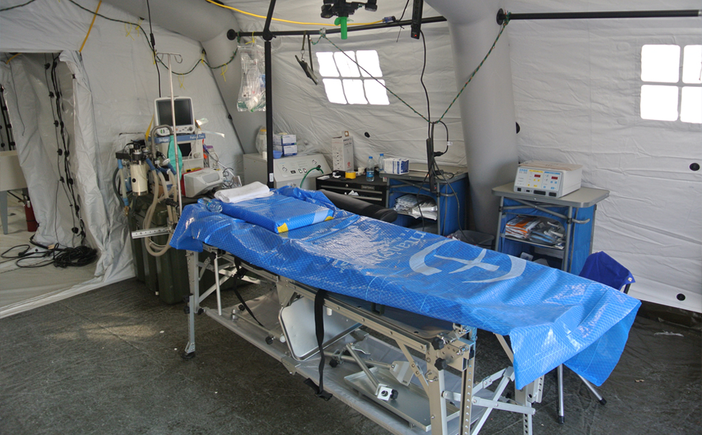 an operating table in one of the hospital tents