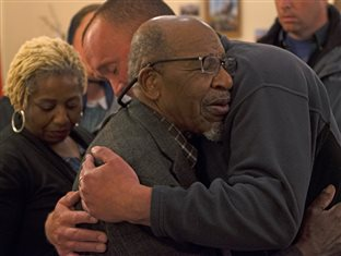 Civil rights icon John Perkins greets Arnold's son Chris